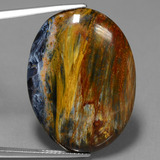 thumb image of 24.5ct Oval Cabochon Multicolor Pietersite (ID: 447779)