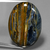 thumb image of 24.5ct Oval Cabochon Multicolor Pietersite (ID: 447784)