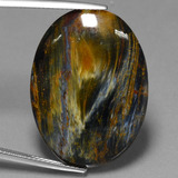 thumb image of 20ct Oval Cabochon Multicolor Pietersite (ID: 447851)