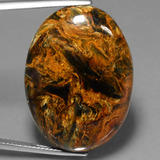 thumb image of 41.7ct Oval Cabochon Multicolor Pietersite (ID: 447855)