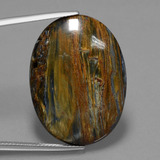 thumb image of 23.7ct Oval Cabochon Multicolor Pietersite (ID: 447878)