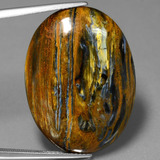 thumb image of 26.7ct Oval Cabochon Multicolor Pietersite (ID: 447923)