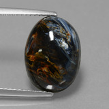thumb image of 6.3ct Oval Cabochon Multicolor Pietersite (ID: 448131)