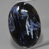 thumb image of 31.2ct Oval Cabochon Multicolor Pietersite (ID: 456182)