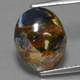 thumb image of 3.5ct Oval Cabochon Multicolor Pietersite (ID: 456325)