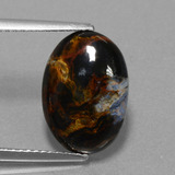 thumb image of 4.2ct Oval Cabochon Multicolor Pietersite (ID: 456508)
