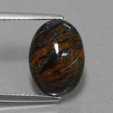 thumb image of 5.2ct Oval Cabochon Multicolor Pietersite (ID: 456511)