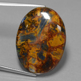 thumb image of 25.5ct Oval Cabochon Multicolor Pietersite (ID: 456558)