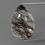 thumb image of 4.5ct Pear Cabochon Colorless Black Rutile Quartz (ID: 402983)