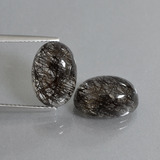 thumb image of 10.4ct Oval Cabochon Colorless Black Rutile Quartz (ID: 403509)