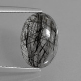 thumb image of 4.7ct Oval Cabochon Colorless Black Rutile Quartz (ID: 404326)