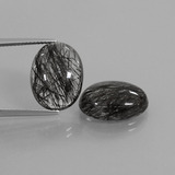thumb image of 16.1ct Oval Cabochon Colorless Black Rutile Quartz (ID: 411281)