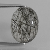 thumb image of 9.5ct Oval Cabochon Colorless Black Rutile Quartz (ID: 411321)