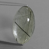 thumb image of 10ct Oval Cabochon Colorless Rutile Quartz (ID: 439077)