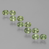 thumb image of 2.6ct Oval Facet Yellowish Green Sapphire (ID: 385610)