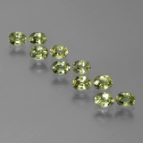 thumb image of 2.5ct Oval Facet Yellowish Green Sapphire (ID: 386187)
