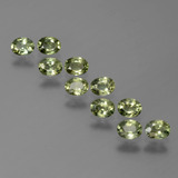 thumb image of 2.3ct Oval Facet Yellowish Green Sapphire (ID: 386191)