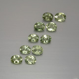 thumb image of 2ct Oval Facet Yellowish Green Sapphire (ID: 386878)