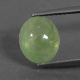 thumb image of 3.9ct Oval Cabochon Yellowish Green Sapphire (ID: 427345)