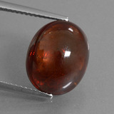 thumb image of 10.6ct Oval Cabochon Red Orange Spessartite Garnet (ID: 424298)