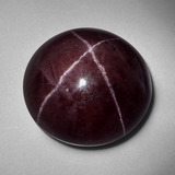 thumb image of 56.5ct Round Cabochon Black Red Star Garnet (ID: 403884)