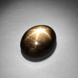 thumb image of 13.1ct Oval Cabochon Black Star Sapphire (ID: 385850)