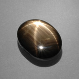 thumb image of 7.5ct Oval Cabochon Black Star Sapphire (ID: 388449)