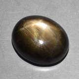 thumb image of 10.1ct Oval Cabochon Black Star Sapphire (ID: 390645)