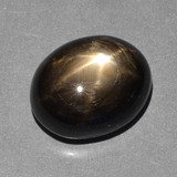 thumb image of 10.2ct Oval Cabochon Black Star Sapphire (ID: 390646)