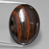 thumb image of 22.7ct Oval Cabochon Multicolor Tiger's Eye Matrix (ID: 405799)
