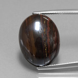 thumb image of 23ct Oval Cabochon Multicolor Tiger's Eye Matrix (ID: 405931)