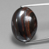 thumb image of 22.3ct Oval Cabochon Multicolor Tiger's Eye Matrix (ID: 405933)