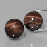 thumb image of 39.6ct Drilled Sphere Multicolor Tiger's Eye Matrix (ID: 422953)
