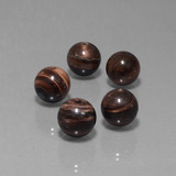 thumb image of 36.7ct Drilled Sphere Multicolor Tiger's Eye Matrix (ID: 423050)