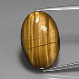 thumb image of 20.2ct Oval Cabochon Gold Brown Tiger's Eye (ID: 389811)