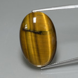 thumb image of 20.8ct Oval Cabochon Gold Brown Tiger's Eye (ID: 389885)