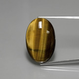 thumb image of 20.2ct Oval Cabochon Gold Brown Tiger's Eye (ID: 389950)
