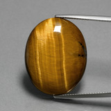 thumb image of 22.9ct Oval Cabochon Gold Brown Tiger's Eye (ID: 389989)