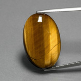 thumb image of 20.7ct Oval Cabochon Gold Brown Tiger's Eye (ID: 389994)