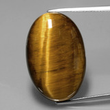 thumb image of 20.3ct Oval Cabochon Gold Brown Tiger's Eye (ID: 390171)