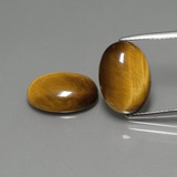 thumb image of 9.1ct Oval Cabochon Gold Brown Tiger's Eye (ID: 390836)