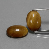 thumb image of 9.1ct Oval Cabochon Gold Brown Tiger's Eye (ID: 390897)