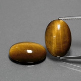 thumb image of 9.1ct Oval Cabochon Gold Brown Tiger's Eye (ID: 391009)
