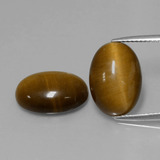 thumb image of 9.1ct Oval Cabochon Gold Brown Tiger's Eye (ID: 396409)