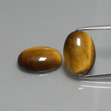 thumb image of 9.1ct Oval Cabochon Gold Brown Tiger's Eye (ID: 396474)