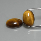 thumb image of 9.1ct Oval Cabochon Gold Brown Tiger's Eye (ID: 396477)
