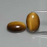 thumb image of 9.1ct Oval Cabochon Gold Brown Tiger's Eye (ID: 396478)