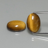 thumb image of 8.8ct Oval Cabochon Gold Brown Tiger's Eye (ID: 396558)