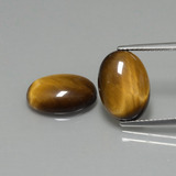 thumb image of 8.8ct Oval Cabochon Gold Brown Tiger's Eye (ID: 396561)