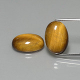 thumb image of 8.9ct Oval Cabochon Gold Brown Tiger's Eye (ID: 396563)